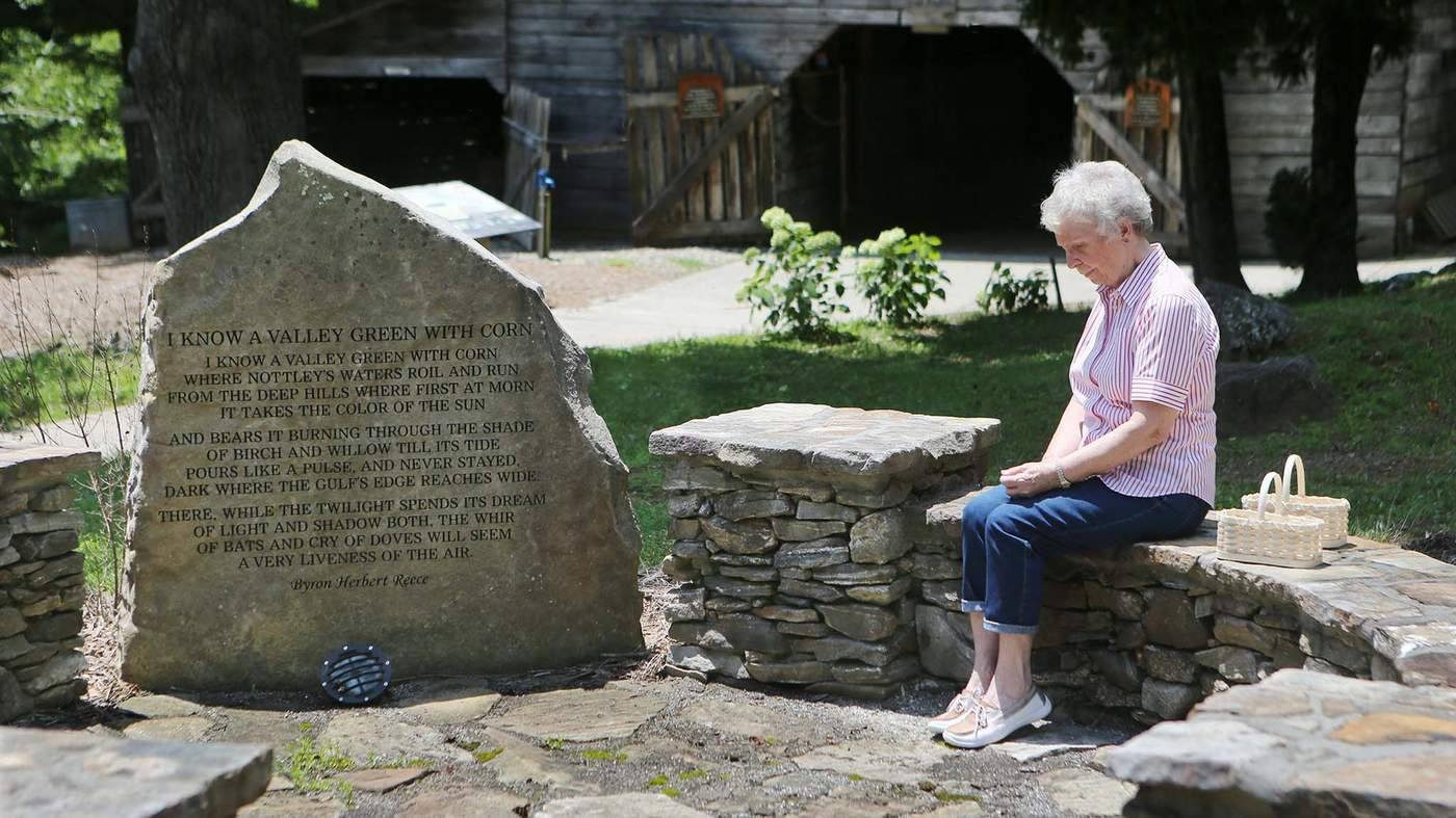 Hannah Barber Sits In One Of The Islands Along Poetry Trail At Byron Herbert Reece Farm And Heritage Center Blairsville Photo ByCurtis Compton